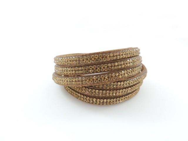 Bracelet coulissant orné de petits cristaux marron noisette